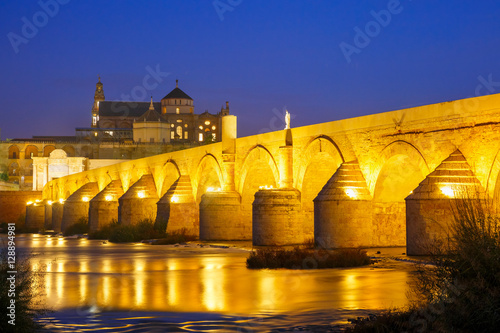 Poster Great Mosque Mezquita - Catedral de Cordoba with mirror reflection and Illuminat