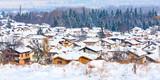Houses with snow roofs panorama banner of bulgarian ski resort Bansko, Bulgaria