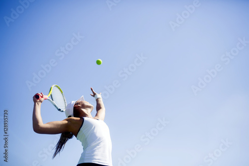 Fotobehang Tennis Beautiful female tennis player serving