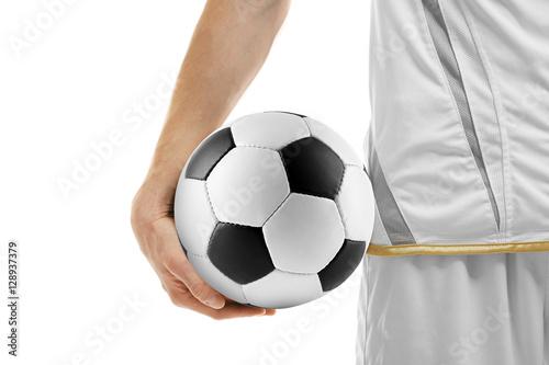 Fotobehang Basketbal Professional football player holding ball on white background, closeup