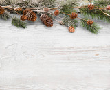 Christmas background with fir branches,pinecones and berries on