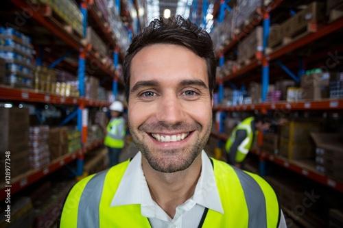 Poszter Happy warehouse worker holding clipboard