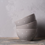 Six ceramic bowls in a stack. Isolated on gray background