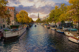 Panorama of canal in old town at fall, day time in Amsterdam.