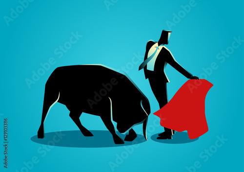 Courageous businessman being a matador