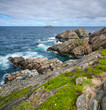 Cape Bonavista featuring coastal slabs of stone boulders and rocks that show their layers of formation over millions of years.  Rocky boulder shoreline in Newfoundland, Canada.