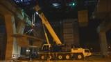 Big crane lifting large cement bar up at express way construction site in Bangkok, Thailand
