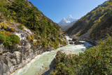 Small river with Ama Dablam mountain background, Everest region,