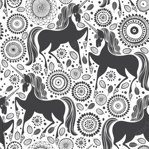 Cotton fabric Fairytale pattern with  unicorns on a floral background. Black and white vector illustration.