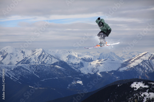 Poster Skier jump on mountains. Extreme sport.