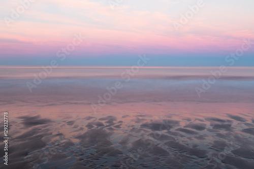 Deurstickers Lichtroze Bamburgh beach Sunset
