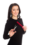 Beautiful girl hairdresser holding scissors and comb