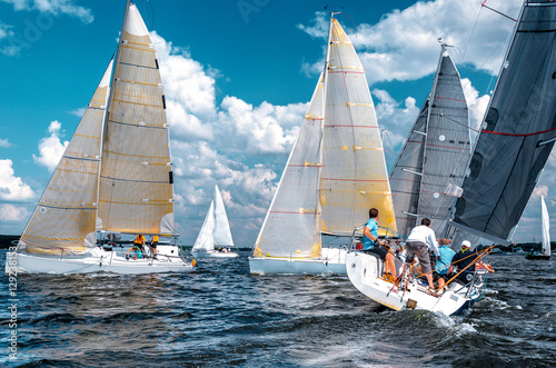 Sailing yacht race, regatta. Team athletes participating in the sailing competition