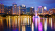 Orlando, Florida City Skyline on Lake Eola at Night (logos blurred for commercial use)