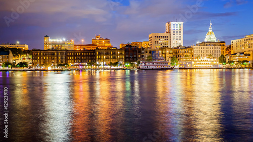 Savannah, Georgia Downtown Skyline and City Lights Across Savannah River at Night © CrackerClips