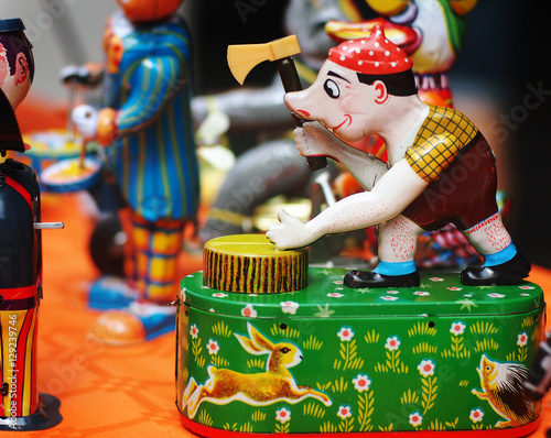 Foto op Canvas Tin toys - An old tin woodcutter in an antiques fair in Italy.