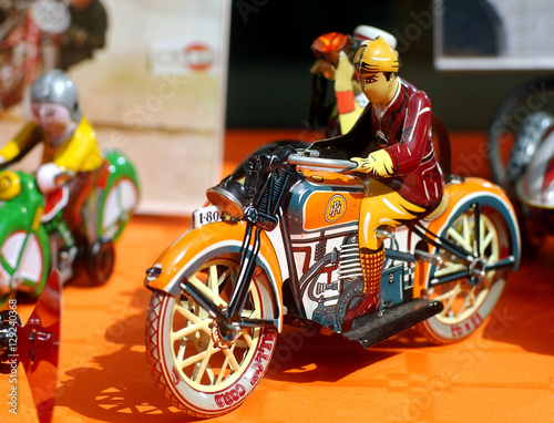 Foto op Canvas Tin toys - An old tin motorcycle rider in an antiques fair in Italy.