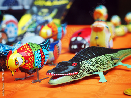 Foto op Canvas Tin toys - two old tin animals (a bird and a crocodile) in an antiques fair in Italy.