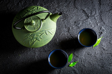 Delicious green tea in Asian restaurant on black rock