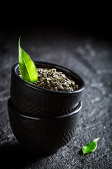 Tasty green tea in Asian restaurant on black rock