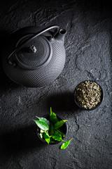Fresh green tea in Asian restaurant on black rock