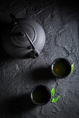 Healthy green tea in Asian restaurant on black rock