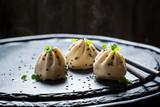 Tasty and hot manti dumplings on black rock