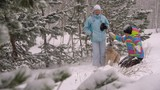 Two Women Playing With a Dog in Winter Forest Slow Motion