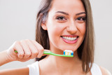 Young woman holding toothbrush. Dental hygiene concept.