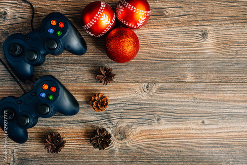 Poster Gamepads on the table. Gaming accessories. Beautiful background.
