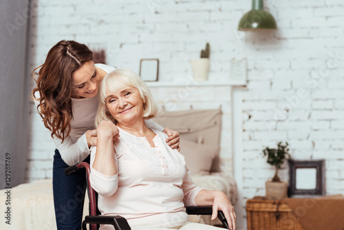 Cheerful elderly woman sittig in the wheelchair