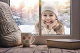 girl looking in window