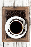 cup of coffee on a wooden tray, vertical top view
