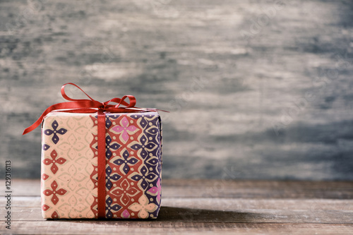 Poster cozy gift on a wooden surface