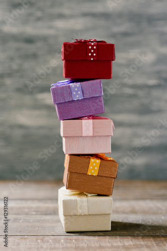 stack of gifts on a wooden surface плакат