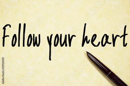 follow your heart text write on paper Poster