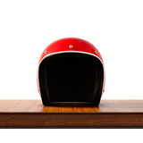 Fototapety Front side view of red color vintage style motorcycle helmet on natural wooden desk.Concept classic object isolated white background.Square.3d rendering.
