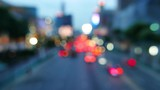 Defocused traffic and city lights on urban big street at dusk. Ratchadamri Road, Bangkok, Thailand.