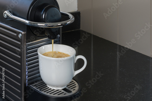 Poster Espresso machine brewing a coffee espresso.