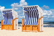 Wicker chairs on sandy Kolobrzeg beach by Baltic Sea, Poland - 129361937