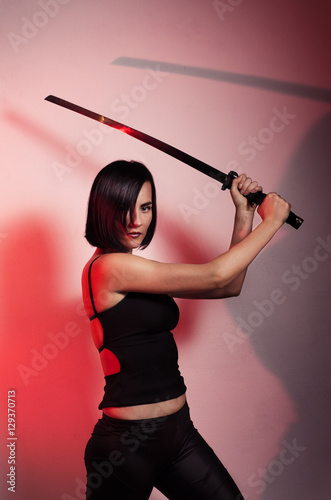 Poster Mystic girl with samurai sword, red glow in background