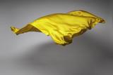 yellow flying fabric