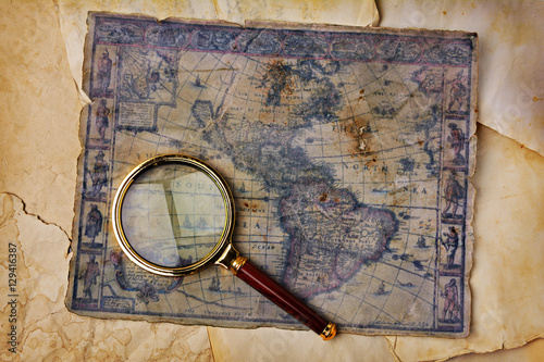 Ancient map and magnifying glass Poster