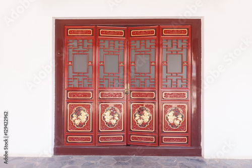 Gateway with red Chinese doors. Poster