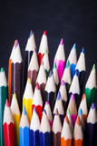 Set of colored pencils for drawing on a dark background.
