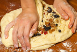 Mixing candied fruit into the dough for Christmas stollen