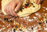 Wheat dough with sweet candied fruit for Christmas stollen, Russ
