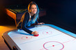 Air hockey game is fun even for adults