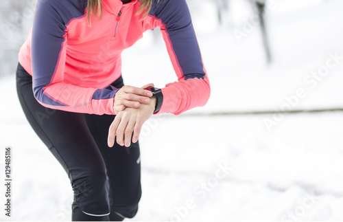 Fitness running woman in winter season