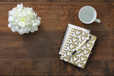 Office supplies on wooden background. Stationery items.